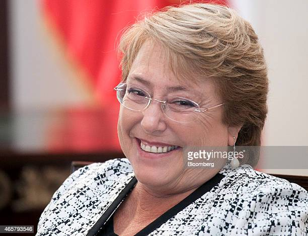 Michelle Bachelet president of Chile smiles during an interview in Santiago Chile on Tuesday March 10 2015 Wages in Chile are rising by the most in...