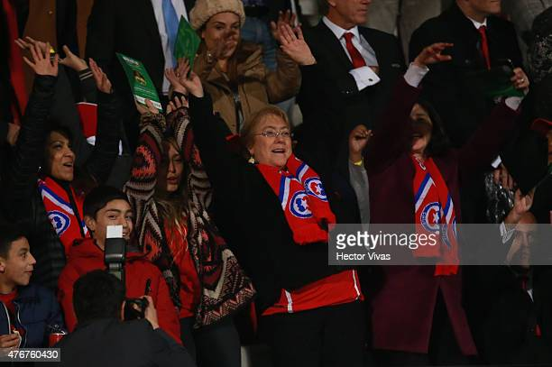 Michelle Bachelet President of Chile waves her hands to cheer for her team during the 2015 Copa America Chile Group A match between Chile and Ecuador...