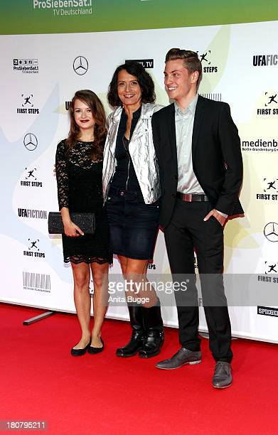 Michelle Barthel Ulrike Folkerts and Jannik Schuemann attend the 'First Steps Award 2013' at Stage Theater on September 16 2013 in Berlin Germany