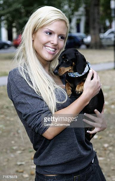 Michelle Bass and her dog Valentina arrives for the Pugs and Kisses Fashion Show in Parsons Green on August 03 2006 in London There will be a Silent...