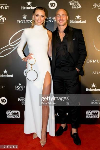 Michelle Battersby and Billy Meakes attends the Glamour On The Grid party on March 11 2020 in Melbourne Australia
