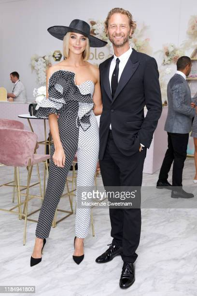 Michelle Battersby and Justin Hemmes attend the Bumble marquee during Derby Day at Flemington Racecourse on November 02, 2019 in Melbourne, Australia.