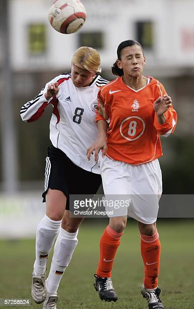 Michelle Baumann of Germany and Carmen Mandauapessy of tghe Netherlands go up for a header during the Women's Under 15 International friendly match...