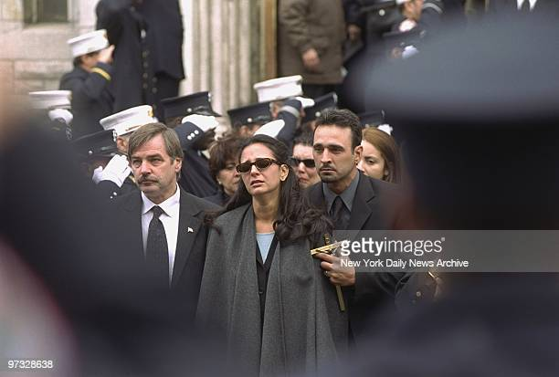 Michelle Bedigian cries during funeral services for her husband Fire Lt Carl Bedigian at St Cecilia's Church in Greenpoint Brooklyn Bedigian lost his...