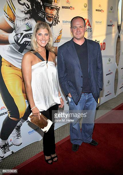 Michelle Beisner and ESPN Sports Anchor Rich Eisen attend the launch party for EA Sports Xbox 360's Madden NFL 10 on July 23 2009 in Santa Monica...