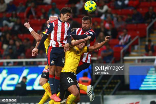 Michelle Benitez of Chivas Alejandro Acosta of Venados and Hedgardo Marin of Chivas struggle for the ball during thematche between Chivas and Venados...