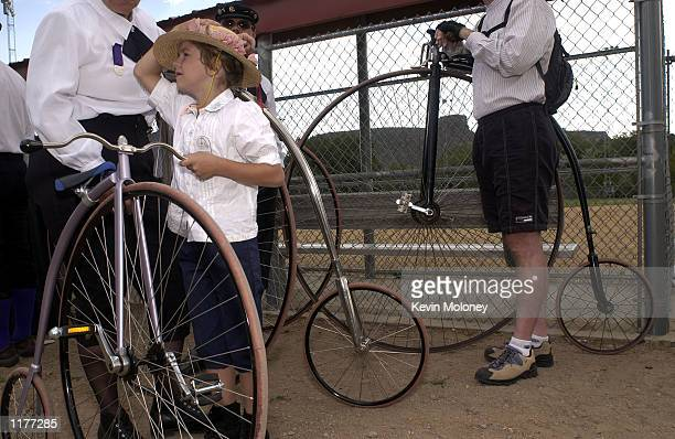Michelle Blake and other members of The Wheelmen an international organization that promotes the restoration and use of antique bicycles line up to...