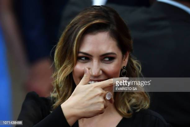 Michelle Bolsonaro gestures during a ceremony in which her husband Brazilian Presidentelect Jair Bolsonaro received a diploma that certifies he can...