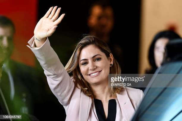 Michelle Bolsonaro the wife of Brazilian presidentelect Jair Bolsonaro waves upon arrival at the transitional government's headquarters in Brasilia...
