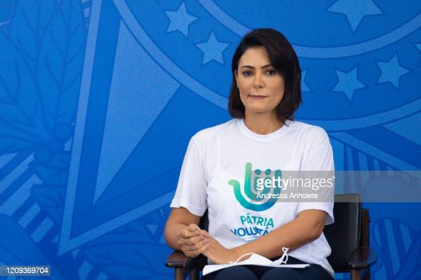 Michelle Bolsonaro Brazilian President Jair Bolsonaro's wife and Chairman of the Management Council of Pátria Voluntária reacts during the...
