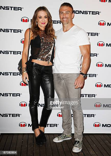 Michelle Bridges and Steve Willis pose at the Monster Headphones Launch Party at The Ivy on November 6 2013 in Sydney Australia
