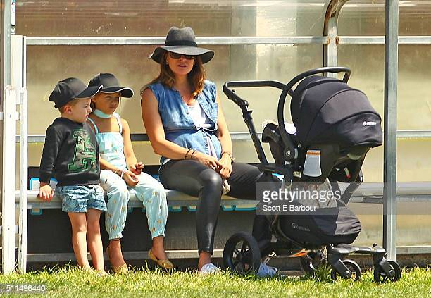 Michelle Bridges with her baby Axel in his pram looks on with Ella and Jack the children of Steve Willis also known as The Commando during the...