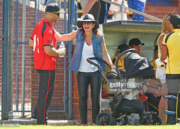 Michelle Bridges with her baby Axel in his pram talks with Steve Willis also known as The Commando during the Medibank Melbourne Celebrity Twenty20...