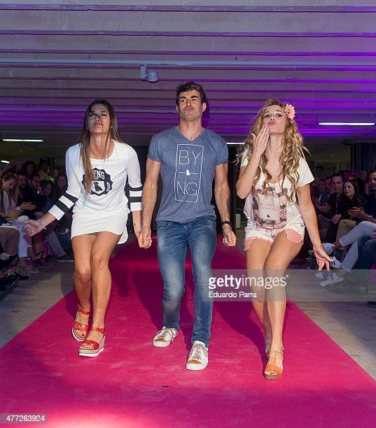Michelle Calvo Daniel Muriel and Natalia Rodriguez walk the runway at the 'By Nerea' show on June 15 2015 in Madrid Spain