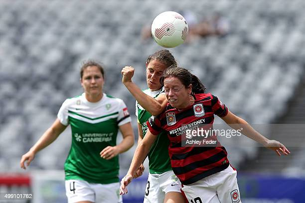Michelle Carney of the Wanderers contests the header against Julia De Angelis of Canberra during the round seven A-League match between the Western...