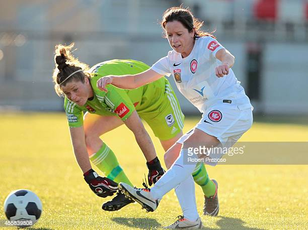 Michelle Carney of the Wanderers scores a goal after beating goal keeper Brianna Davey of the Victory during the round two WLeague match between the...