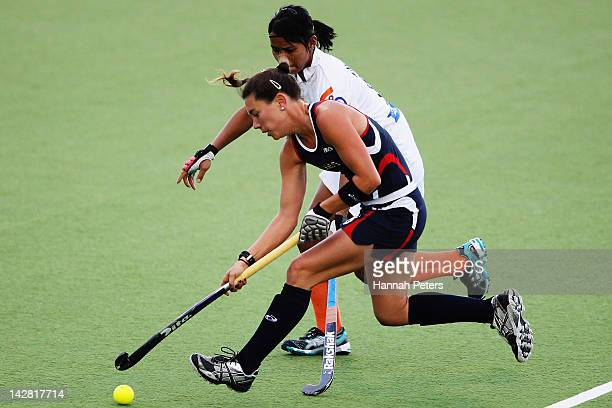 Michelle Cesan of the USA competes for the ball with Navneet Kaur of India during the Four Nations match between India and the United States of...