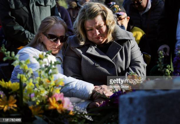 Michelle Chagaris left and Diane Kloepfer comfort each other during a funeral service for Chagaris' sister Marlyse Honeychurch and her daughter Marie...