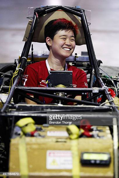 Michelle Chao driver of the Massachusetts Institute of Technology Solar Electric Vehicle Team sits inside her car during scrutineering for the 2015...