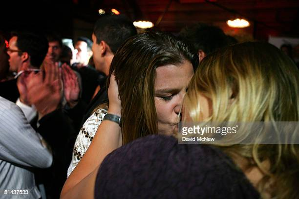 Michelle Chase and Ani Engelman kiss during a symbolic group commitment ceremony for samesex couples to kick off National Gay Pride Month at The...