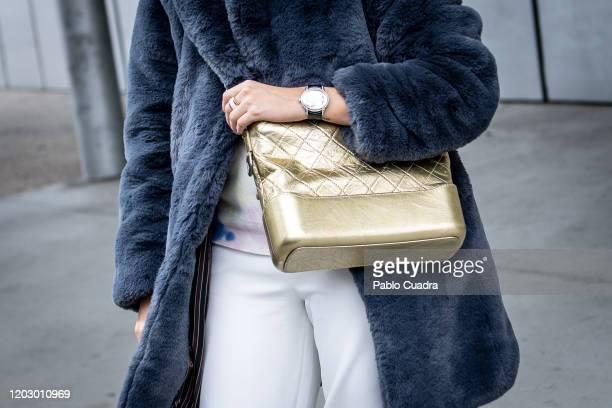 Michelle Chwoschtschinsky wears Stella McCartney shoes, Audermars Piguet watch, Essentiel trousers, Coco Chanel handbag and Dior hat at IFEMA during...