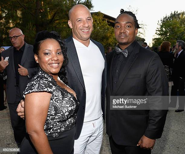 Michelle Coffey actor Vin Diesel and recipient of the John Dillon Award Darius Coffey inside the 13th Annual Chrysalis Butterfly Ball sponsored by...