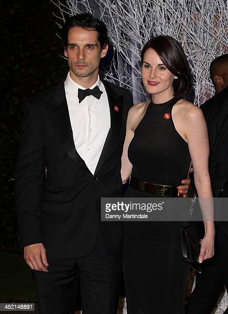 Michelle Dockery and boyfriend John Dineen attend the Winter Whites Gala in aid of Centrepoint at Kensington Palace on November 26 2013 in London...
