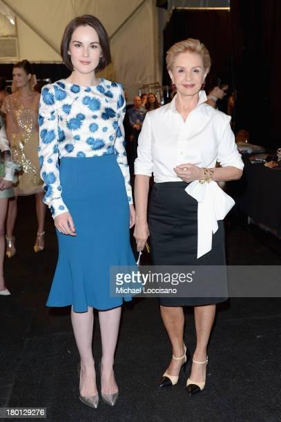 Michelle Dockery and Carolina Herrera pose backstage at the Carolina Herrera fashion show during MercedesBenz Fashion Week Spring 2014 at The Theatre...