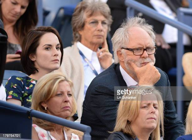 Michelle Dockery and John Lithgow attend the 2013 US Open at USTA Billie Jean King National Tennis Center on September 6, 2013 in New York City.