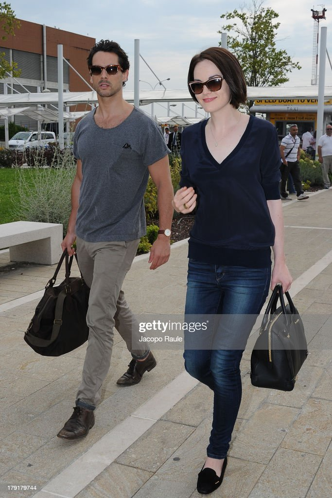 Michelle Dockery and John Patrick Dineen are seen leaving the Venice Airport during The 70th Venice International Film Festival on September 1, 2013 in Venice, Italy.