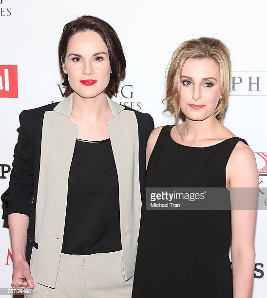 Michelle Dockery and Laura Carmichael arrive at the 'Downton Abbey' photo call held at The Beverly Hilton Hotel on August 6 2013 in Beverly Hills...