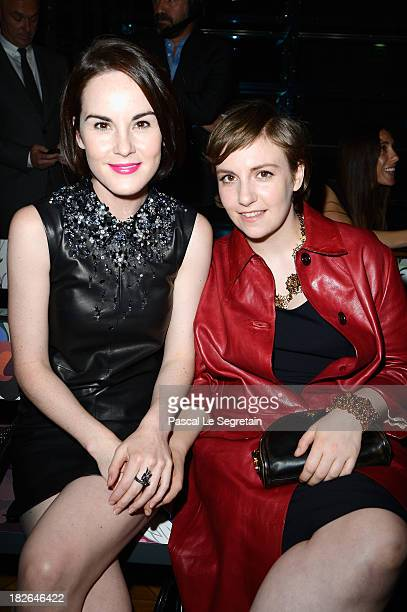 Michelle Dockery and Lena Dunham attend the Miu Miu show as part of the Paris Fashion Week Womenswear Spring/Summer 2014 at Palais d'Iena on October...