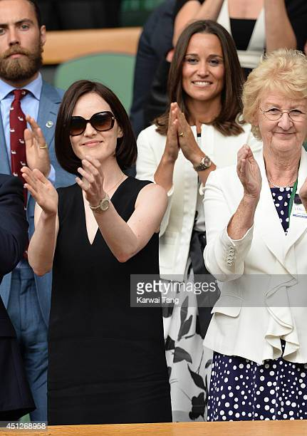 Michelle Dockery and Pippa Middleton attend the Angelique Kerber v Heather Watson match on centre court during day four of the Wimbledon...