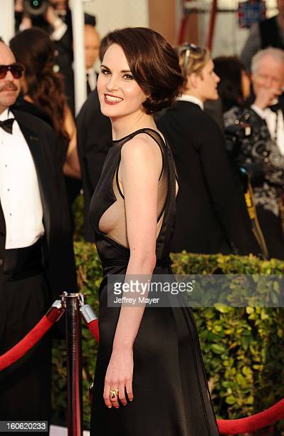Michelle Dockery arrives at the 19th Annual Screen Actors Guild Awards at the Shrine Auditorium on January 27 2013 in Los Angeles California