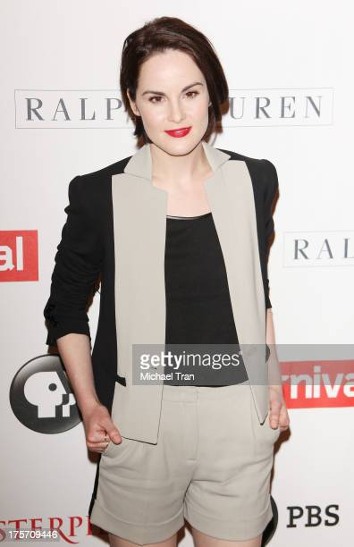 Michelle Dockery arrives at the 'Downton Abbey' photo call held at The Beverly Hilton Hotel on August 6 2013 in Beverly Hills California