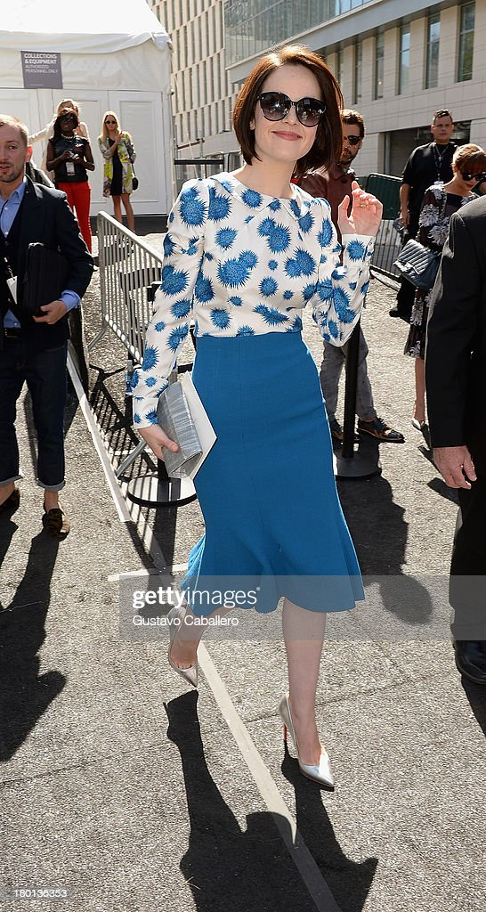 Michelle Dockery attends Day 5 of Mercedes-Benz Fashion Week Spring 2014 at Lincoln Center for the Performing Arts on September 9, 2013 in New York City.