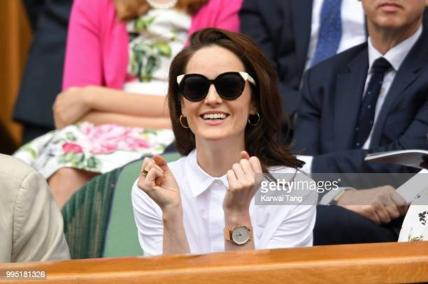 Michelle Dockery attends day eight of the Wimbledon Tennis Championships at the All England Lawn Tennis and Croquet Club on July 10 2018 in London...
