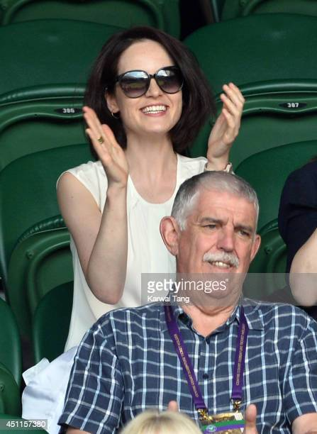 Michelle Dockery attends the Martin Klizan v Rafael Nadal match on centre court during day two of the Wimbledon Championships at Wimbledon on June...
