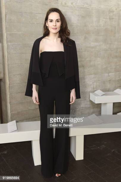 Michelle Dockery attends the Roland Mouret show during London Fashion Week February 2018 at The National Theatre on February 18 2018 in London England