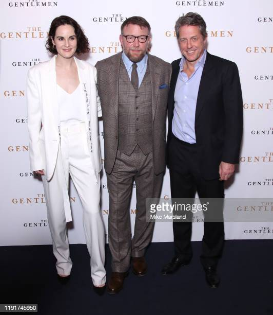 Michelle Dockery Guy Ritchie and Hugh Grant attend The Gentleman Special Screening at The Curzon Mayfair on December 03 2019 in London England