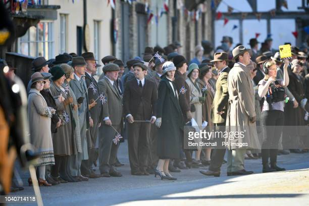 Michelle Dockery is joined by Stephen Campbell Moore and other cast members on the Downton Abbey film set in Lacock Wiltshire