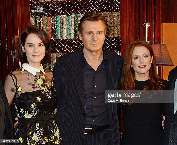 Michelle Dockery Liam Neeson and Julianne Moore attend a photocall for 'NonStop' at China Tang at The Dorchester on January 30 2014 in London England