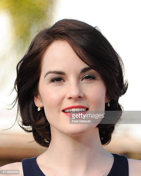 Michelle Dockery visits 'Extra' at Universal Studios Hollywood on February 24 2014 in Universal City California
