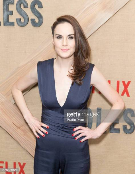 Michelle Dockery wearing jump suite by Galvan attends Netflix Godless premiere at Metrograph
