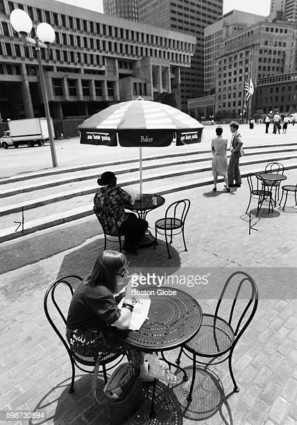 Michelle Doucet of Melrose Mass enjoys her lunch on City Hall Plaza in Boston on July 6 1994