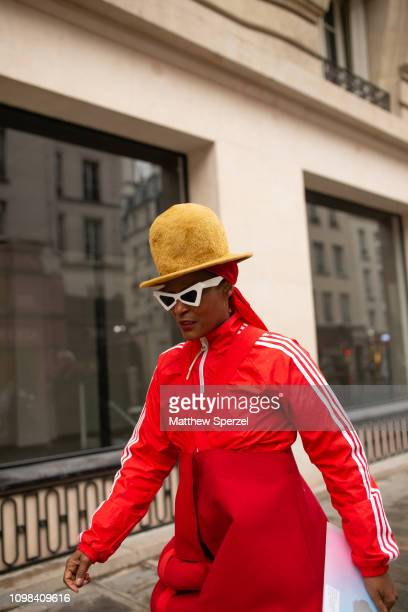 Michelle Elie is seen attending JEAN PAUL GAULTIER during Paris Haute Couture Fashion Week wearing red track jacket with avant garde red pants, gold...