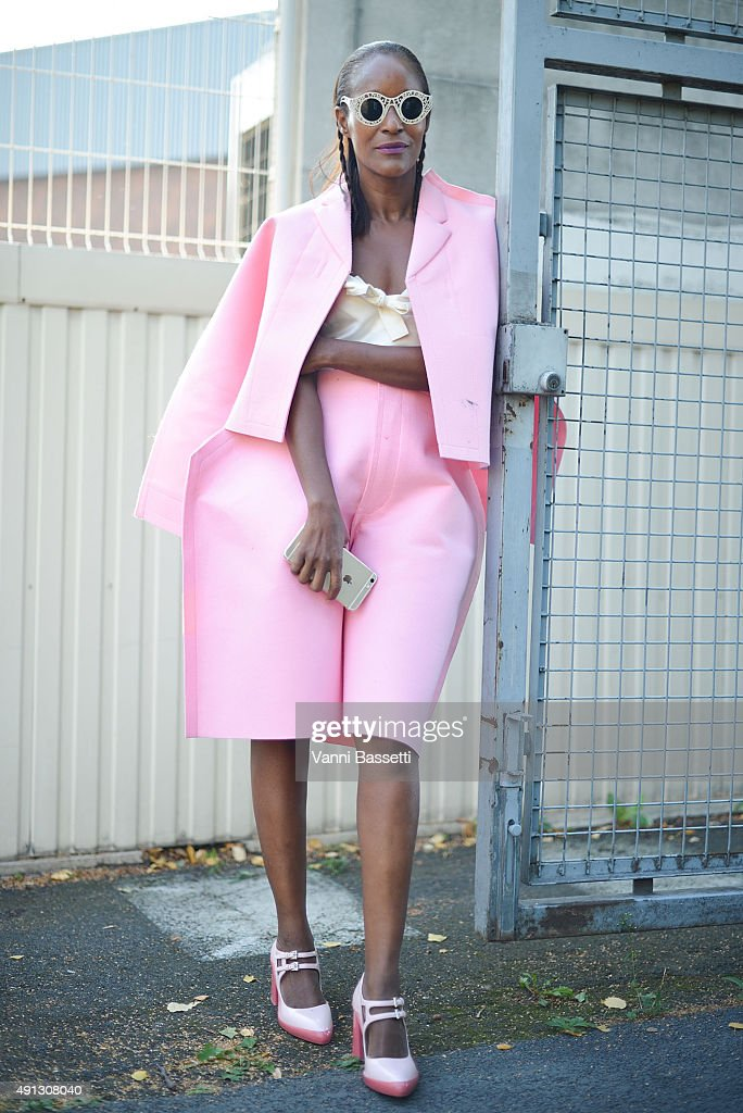 Michelle Elie poses wearing Comme des Garcons jacket and pants, Miu Miu top and Prada shoes after the Kenzo show at the Paris Event Center during Paris Fashion Week SS16 on October 4, 2015 in Paris, France.