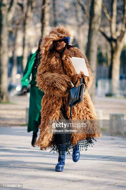 Michelle Elie wears a brown faux fur coat during Paris Fashion Week Haute Couture Spring Summer 2020 on January 21 2019 in Paris France