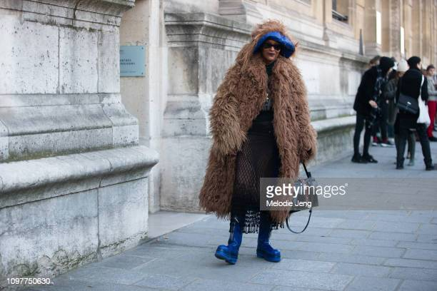 Michelle Elie wears a brown fur fuzzy Marni coat and blue boots during Couture SS19 Fashion Week on January 21 2019 in Paris France