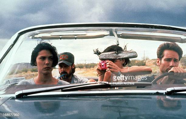 Michelle Forbes Brad Pitt Juliette Lewis and David Duchovny in a car in a scene from the film 'Kalifornia' 1993